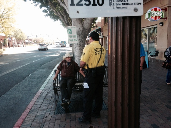 Man perceived to be homeless is asked to leave the bus station premises by security personnel of the Tempe, Arizona downtown business center.